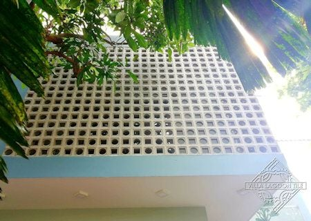 Maldives and Aruba Breeze Blocks define this building's facade, from Villa Lagoon Tile.