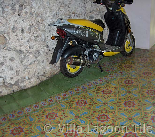 Caribbean tile entrance hall with motorscooter