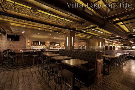 Villa Lagoon Tile's Herringbone Cement Tile in The Franklin Room, Chigago.