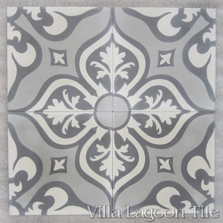 Lancelot Gray cement tile samples on the warehouse floor.