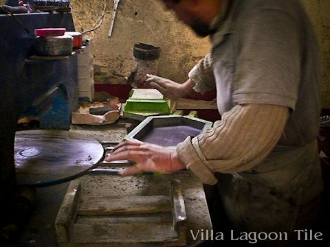 One of our master artisans in Morocco assembling a mold.