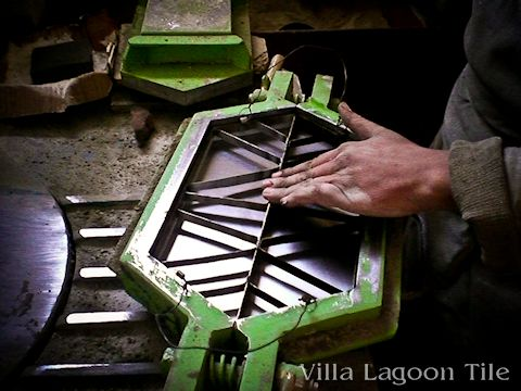 The tile maker inserts the pattern mold into the shape mold.