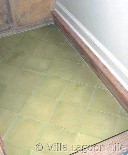Solid color cement tiles on a stair landing