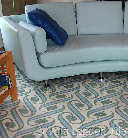 Cement tile in a living room with blue sofa