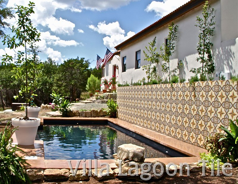Cement tiles on swimming pool wall in landscape