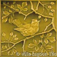 Antique bird tile in yellow green glaze