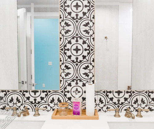 """Tulips"" black and white cement tile bathroom wall, from Villa Lagoon Tile."