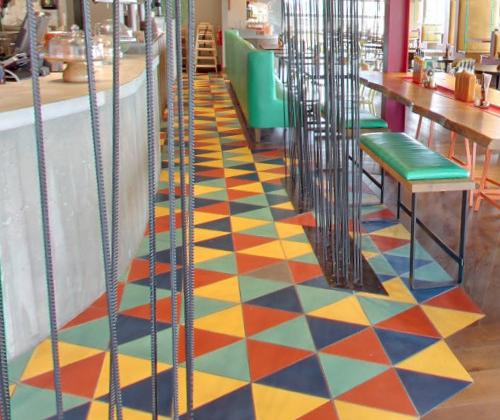 Wild restaurant floor with triangular cement tile, from Villa Lagoon Tile.