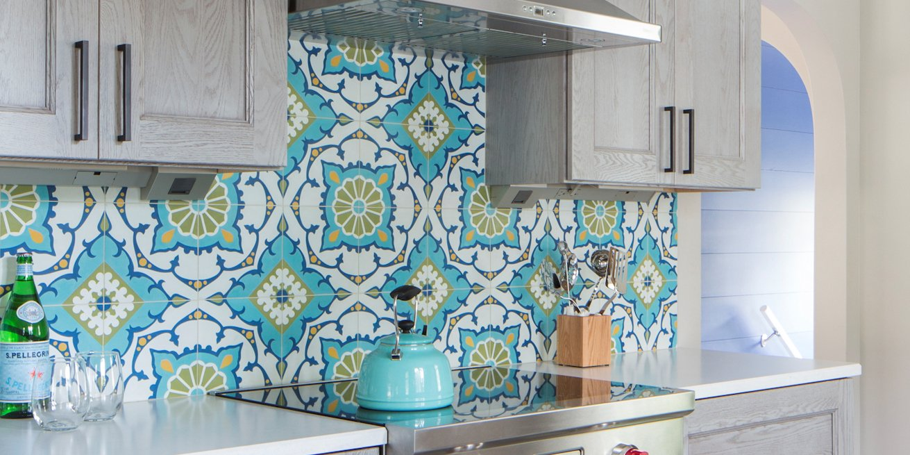 Colorful patchwork cement tile kitchen range backsplash, from Villa Lagoon Tile.