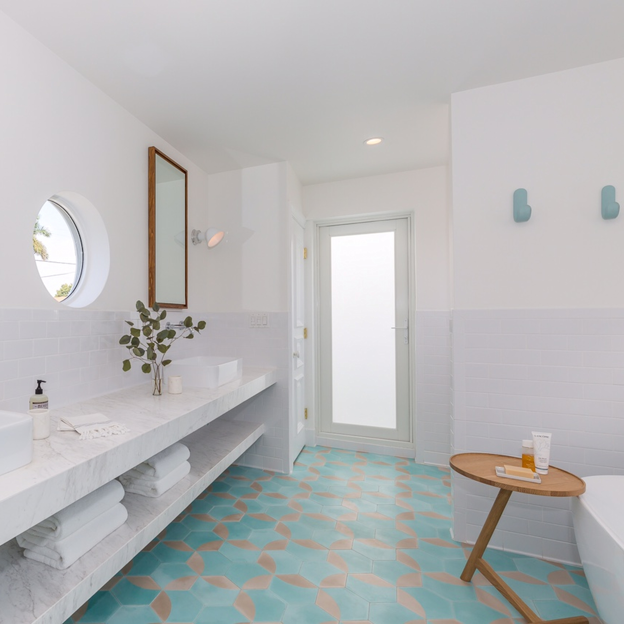 An elegant cement tile bathroom floor, with matching border, from Villa Lagoon Tile.