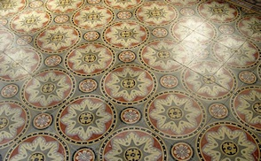 A beautiful antique cement tile floor, in a historic French abbey, photographed on a Villa Lagoon Tile research tour.