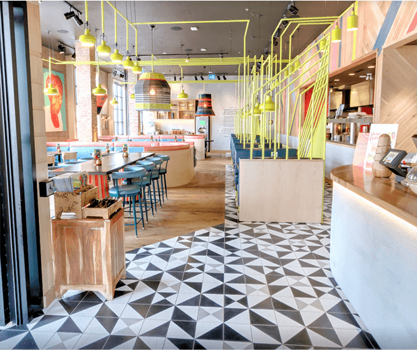 Geometric black, white, and gray cement tile restaurant floor, by Villa Lagoon Tile.